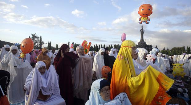 Indonesian Muslim women perform at Eid al-Fitr prayers (Firdia Lisnawati/AP)