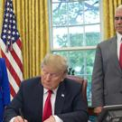 President Donald Trump signs an executive order to keep families together (Pedro Martinez Monsivais/AP)