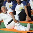 Indian Prime Minister Narendra Modi performs yoga along with thousands of other Indians (Manish Swarup/AP)