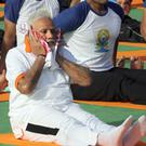 Indian Prime Minister Narendra Modi wipes away sweat during yoga exercises (Manish Swarup/AP)