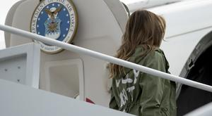 First lady Melania Trump boards a plane at Andrews Air Force Base (Andrew Harnik/AP)
