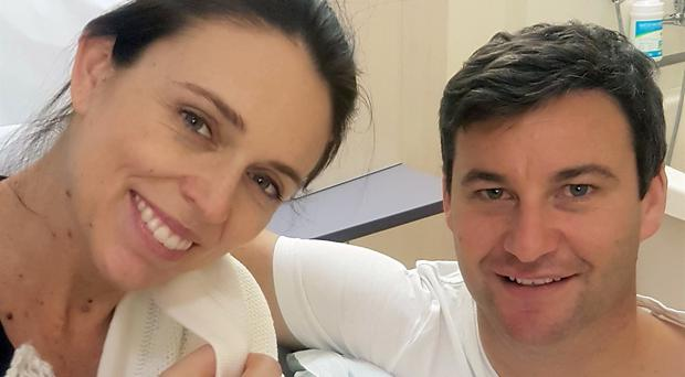 Prime Minster Jacinda Ardern and her partner Clarke Gayford pose with their newborn daughter (Office of the Prime Minister of New Zealand/AP)