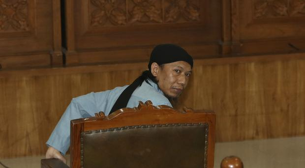 Radical Islamic cleric Aman Abdurrahman sits at the court room for his sentencing hearing (Tatan Syuflana/AP)