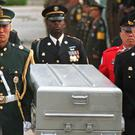 Honour guards carry a coffin containing the remains of American soldiers (Ahn Young-joon/AP)