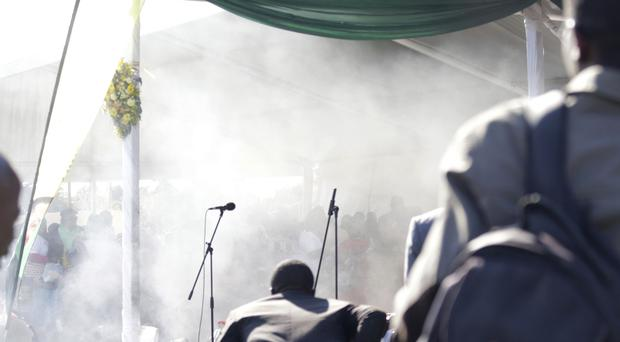 Smoke fills the stage following an explosion at a ZanuPF rally in Bulawayo. (AP)