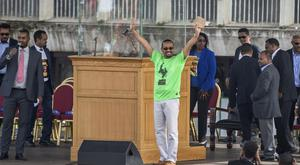 Ethiopia's Prime Minister Abiy Ahmed waves to the crowd (Mulugeta Ayene/AP)