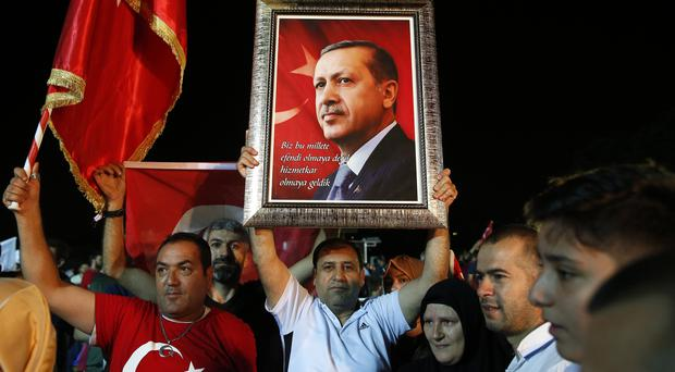 Supporters of Turkey's President Recep Tayyip Erdogan gathered to listen to an earlier victory speech (AP Photo/Lefteris Pitarakis)