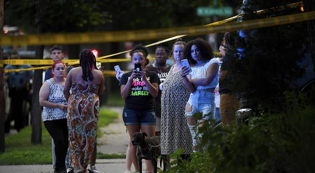 A crowd gathers near the scene of a shooting in Minneapolis (AP)