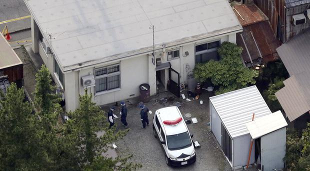 Investigators work at a police station in Toyama, northwest of Tokyo (AP)