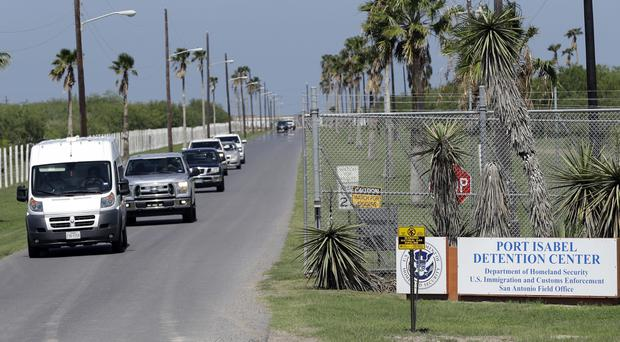 Vehicles leave the Port Isabel Detention Centre, which holds detainees of the US immigration and customs enforcement department (AP)