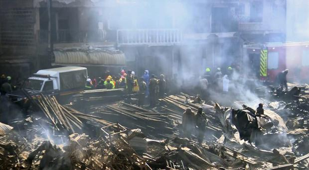 Emergency services at the scene of a fire at a marketplace in Nairobi (AP)