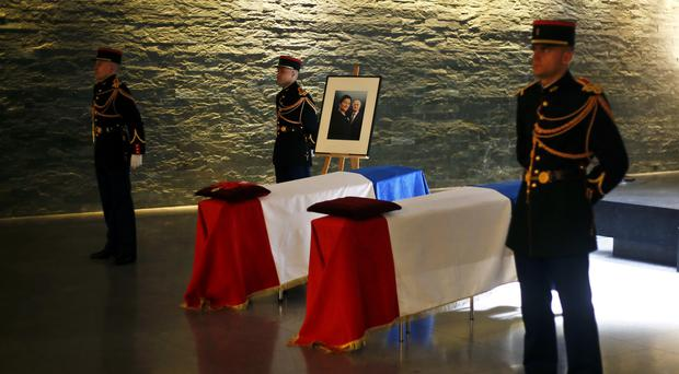 The flag-draped coffins of French politician Simone Veil, right, and her husband Antoine Veil are displayed at the French Holocaust memorial in Paris (Thibault Camus/AP))