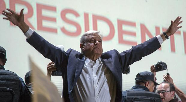 Presidential candidate Andres Manuel Lopez Obrador acknowledges his supporters as he arrives in Mexico City's main square, the Zocalo (Anthony Vazquez/AP)