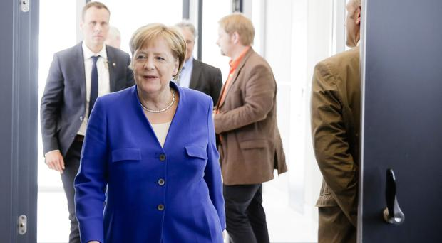 Angela Merkel had been in a stand-off (AP Photo/Markus Schreiber)