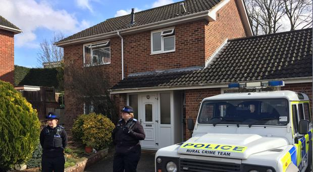 Police Community Support Officers standing outside the Salisbury home of Sergei Skripal (Ben Mitchell/PA)