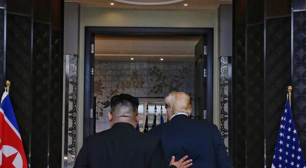 Kim Jong Un and Donald Trump during their meeting in Singapore (Kevin Lim/AP)