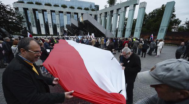 Poles protesting on Sunday against new legislation on the Supreme Court that will force the retirement of more than a third of the judges (Czarek Sokolowski/AP)
