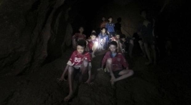 The boys and their coach as they were found in a partially flooded cave in Thailand (Tham Luang Rescue Operation Center via AP)