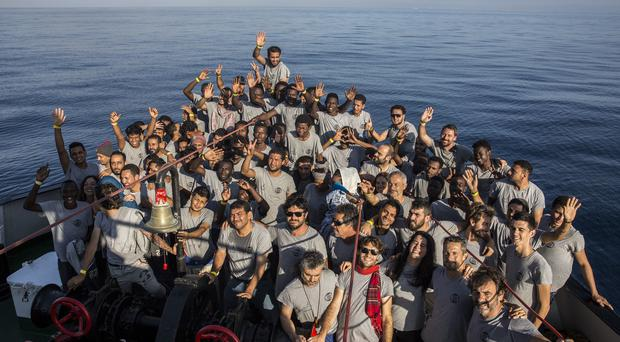 Migrants and crew members aboard the Open Arms aid boat arrived in Barcelona (Olmo Calvo/AP)