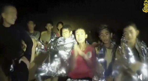 The trapped boys with navy Seals inside the cave in northern Thailand (Thai Navy Seal via AP)