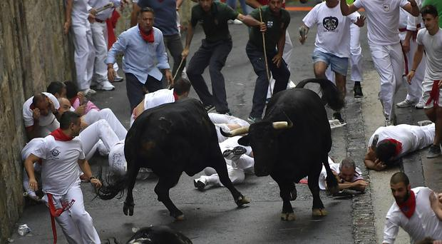 The running of the bulls at the San Fermin Festival (AP Photo/Alvaro Barrientos)