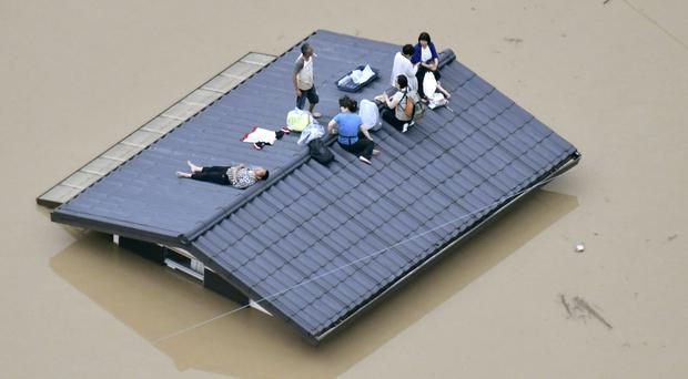 A submerged house in Kurashiki (Shingo Nishizume/Kyodo News via AP)