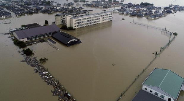 The compound of a junior high school is submerged after heavy rains in Kurashiki (Koji Harada/Kyodo News via AP)