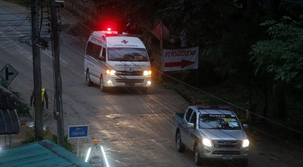 One of two ambulances leave the cave in northern Thailand (Sakchai Lalit/AP)