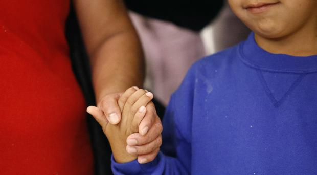 Some families will be reunited following their separation at the US border (AP Photo/Patrick Semansky, File)