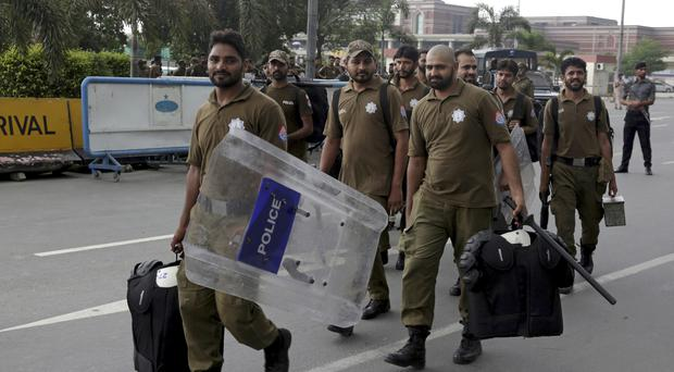 Pakistani police are deployed at Lahore airport (AP Photo/K.M. Chaudary)
