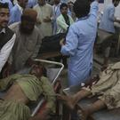 Hospital staff treat people injured in a bomb blast, at a hospital in Quetta (Arshad Butt/AP)