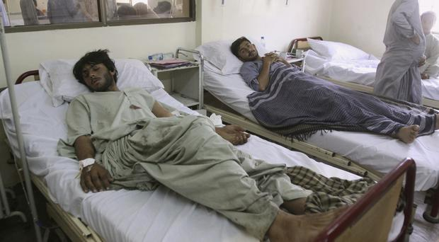Injured people in hospital following Friday's suicide bombing (Arshad Butt/AP)