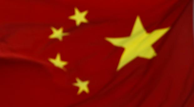 China's economic growth slowed in the second quarter (AP Photo/Andy Wong)
