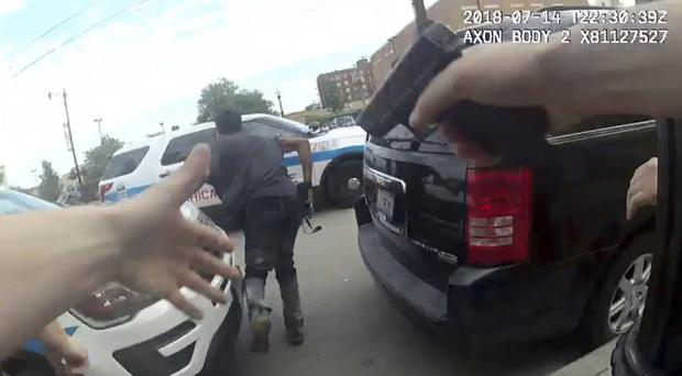 A frame grab from police body cam video shows authorities trying to apprehend a suspect (Chicago Police Department via AP)
