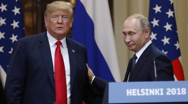 US President Donald Trump and Russian President Vladimir Putin after their meeting at the Presidential Palace in Helsinki (Alexander Zemlianichenko/AP)