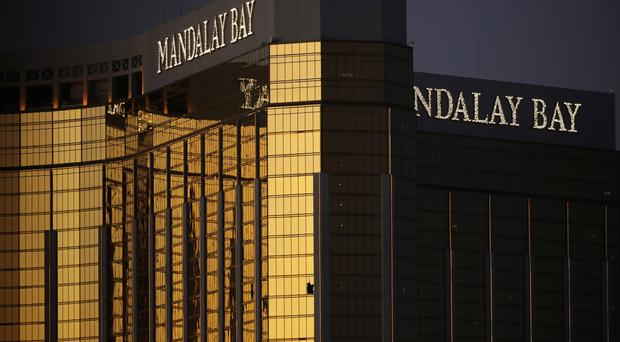 Stephen Paddock opened fire on revellers at a country music festival from a suite at the Mandalay Bay (AP)
