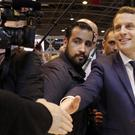 Then presidential candidate Emmanuel Macron, flanked by his bodyguard, Alexandre Benalla (Christophe Ena/AP)