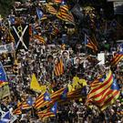 Demonstrators in Barcelona take part during a protest in support of imprisoned politicians (Manu Fernandez/AP)