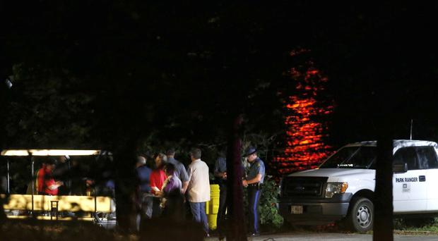 Rescue crews work at the scene of the accident (Andrew Jansen/The Springfield News-Leader/ AP)