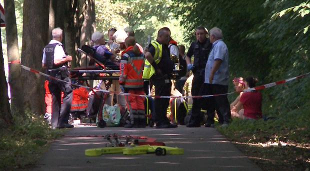 Emergency services attend the scene (AP)
