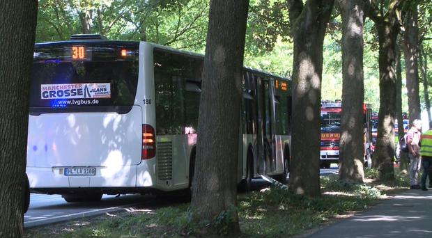 A bus stands on a street in Luebeck, northern Germany, after a man attacked people inside. (TNN/AP)