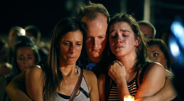 Mourners attend a candlelight vigil for those who died in the duck boat accident (AP Photo/Charlie Riedel)