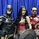 Armando Abarca, dressed as Batman, left, and Jessica Rose Davis, dressed as Wonder Woman, of Los Angeles, and Guillermo Gonzalez, of Sacramento, Calif., dressed as Iron Man (Chris Pizzello/Invision/AP)
