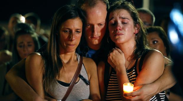 A candlelight vigil is held for the victims (AP)