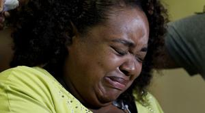 Duck boat accident survivor Tia Coleman has recalled the moments after the accident (AP Photo/Charlie Riedel)