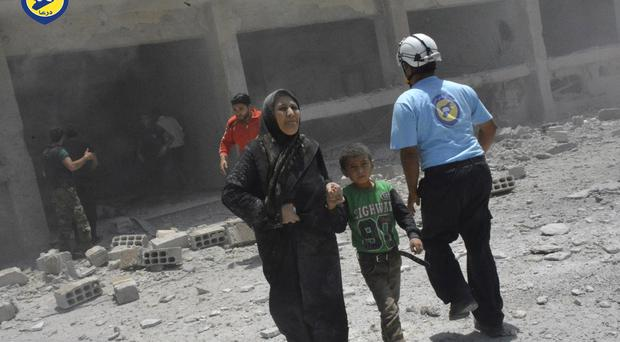 The White Helmets risk their lives to save civilians during air strikes (Syrian Civil Defense White Helmets via AP, File)