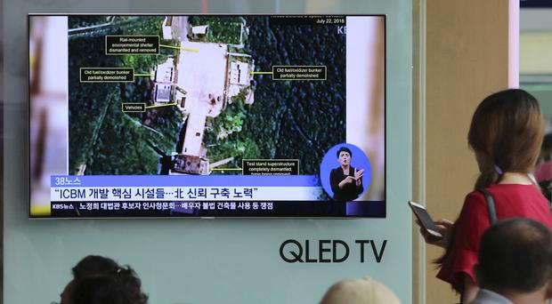 A US research group says North Korea has started dismantling key facilities at its main Sohae satellite launch site in what appears to be a step towards fulfilling a commitment made by leader Kim Jong Un at his summit with President Donald Trump in June (Ahn Young-joon/AP)