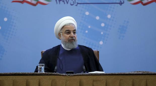 Mr Rouhani shrugged off his US conterpart's threats (AP)