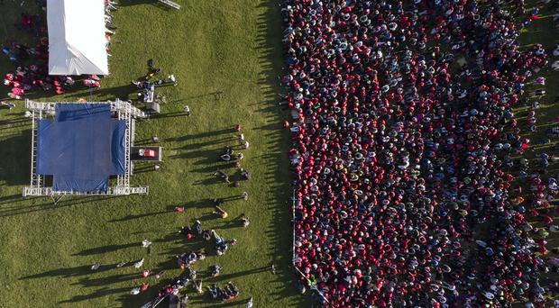 Thousands of opposition party supporters cheer leading opposition challenger Nelson Chamisa (AP)