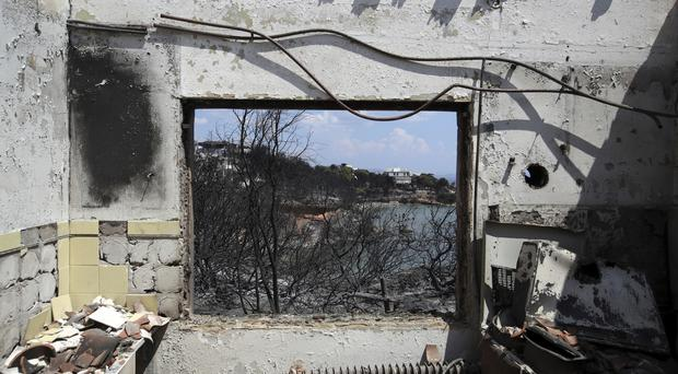 A burned house following the wildfires in Greece (Thanassis Stavrakis/AP)